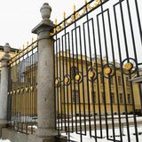 Fragment of a forged lattice with gold ornaments in front of the Grand-Ducal tomb in the Peter and Paul Fortress in St. Petersburg royalty free stock image