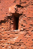 Fragment of the fortification wall with embrasure. Fragment of the brick wall of the fortress with embrasure. Architecture, fortification, exterior royalty free stock photo