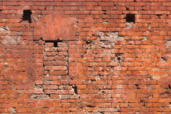 Fragment of the fortification wall with embrasure. Fragment of the brick wall of the fortress with embrasure. Architecture, fortification, exterior royalty free stock photography