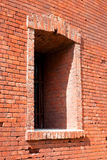 Fragment of the fortification wall with embrasure. Fragment of the brick wall of the fortress with embrasure. Architecture, fortification, exterior royalty free stock photos