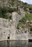 Fragment of the fortress near the South Gate also known as the Gurdic Gate of the Old Town of Kotor, Gurdic Bastion, fortificati. Ons of Kotor, Montenegro. Old Royalty Free Stock Photography