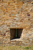 Fragment of the fortress wall with embrasure. Fragment of ancient fortress wall with embrasure. Architecture, exterior, background stock image