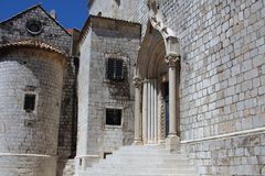 Fragment of the fortress wall and the entrance to the Catholic Cathedral in Dubrovnik, Croatia. royalty free stock photo
