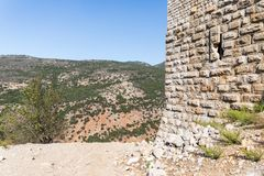 Fragment of the fortress wall near the secret entrance to Nimrod Fortress located in Upper Galilee in northern Israel on the borde. R with Lebanon royalty free stock image