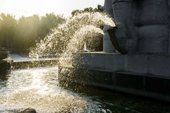 Fragment of fountain water drops in the air. On the Sunset Royalty Free Stock Photo