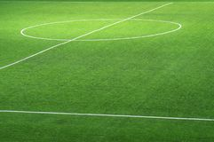 Fragment of a fresh green football field with a marking for the background stock photography