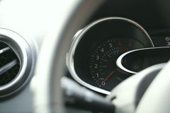 Fragment of the front dashboard of a modern car. royalty free stock photography