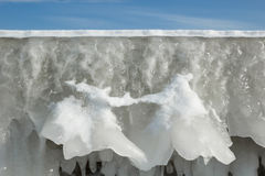 Fragment of a frozen breakwater wall with icicles Royalty Free Stock Image