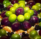 Fragment of fruity cake with grapes in jelly with syrup Stock Photos