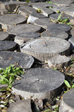 Fragment of garden decor of wood scraps round logs (portrait) Stock Images