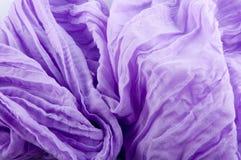 Fragment of gathered purple soft waved fabric gathered Stock Image