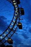 Fragment of giant ferris wheel under dramatic sky Stock Photography