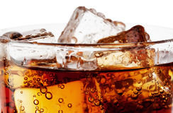 Fragment of glass cola with ice Royalty Free Stock Images