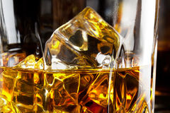 Fragment of a glass of whiskey with ice Stock Photography