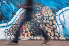 Fragment of graffiti on Berlin Wall at East Side Gallery Royalty Free Stock Images