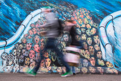 Fragment of graffiti on Berlin Wall at East Side Gallery  and now is largest world graffiti gallery. Royalty Free Stock Photos