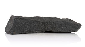 Fragment of granite. On a white background Royalty Free Stock Photography