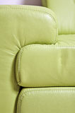 Fragment of green leather sofa. Headboard stock photo