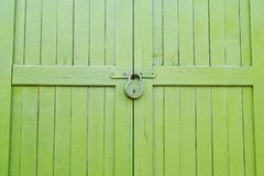 Fragment of green locked outdoor stock photos