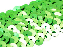 Fragment of green spangle ribbon close-up Royalty Free Stock Image