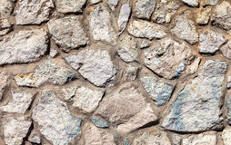 Fragment of a grey stone wall Royalty Free Stock Images