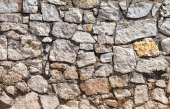 Fragment of a grey stone wall Royalty Free Stock Photo