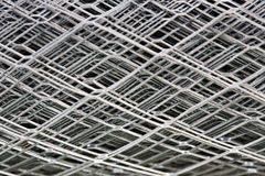 Fragment of a grid metal. Fragment of a metal grid in a roll Royalty Free Stock Photo