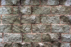 Fragment of grunge stone wall Stock Photos