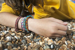 Fragment of hand of teen with braslet Royalty Free Stock Photography