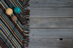 Fragment of handmade knitted fabric, knitting needles and balls Royalty Free Stock Photos