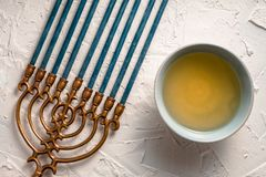 Fragment of Hanukkah and a bowl of olive oil top view Stock Photo