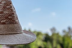 Fragment of a hat on a blurred background. Close up. Details of a straw hat stock image