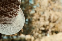 Fragment of a hat on a blurred background. Close up. Details of a straw hat royalty free stock image