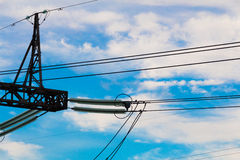 Fragment of heavy high voltage electric pylon of power line Stock Photos