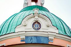 Fragment of a historic building in St. Petersburg, close-up. Roof with a clock royalty free stock photos