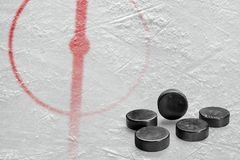 Fragment of the hockey arena with a central circle and washers. Fragment of the hockey arena with markings and washers. Concept, hockey royalty free stock photo