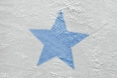 Fragment of the hockey arena and the image of the blue star. Blue star on the ice hockey arena. Concept, hockey, background, sign, symbol stock image