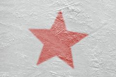 Fragment of the hockey arena and the image of the red star. Red star on the ice hockey arena. Concept, hockey, background, sign, symbol royalty free stock photos