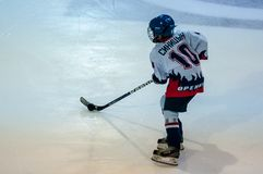 A fragment of the hockey penalty shot performed by the young hockey player Stock Image