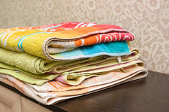 Fragment of a home wardrobe with towels Royalty Free Stock Photo