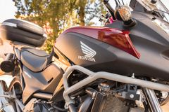 fragment of Honda motorbike at sunset time stock images
