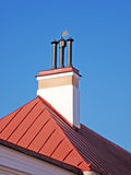 Fragment of house with smokestack. Stock Photography