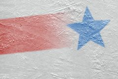 Fragment of the ice arena with a red line and a blue star image. The red line, the blue star and the hockey arena. Concept, hockey, season, background stock photos