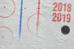 Fragment of ice hockey arena with markings and puck. Ice hockey arena with markup and puck. Hockey, season, concept stock photography