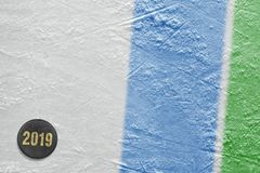 Fragment of the ice hockey arena, puck, blue and green lines stock images