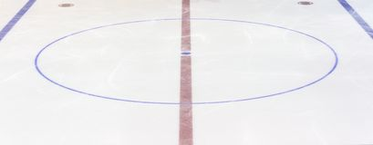 Fragment of ice hockey rink with a central circle. Concept, hockey royalty free stock photography