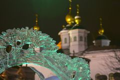 Fragment of an ice sculptures on the background of an Orthodox church. Concept: winter art, holiday stock photo