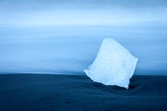 Fragment of iceberg on the beach near Jokulsarlon, Iceland Stock Photos