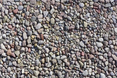 Fragment of an ideal sea stone beach Royalty Free Stock Photos