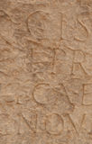 Fragment of an inscription in ancient Greek on the ancient marbl Stock Photos